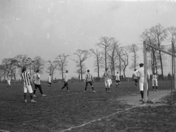 A football match taking place somewhere in Pembrokeshire, South Wales. All the men, including the goalkeeper, are looking across to the top corner of the pitch