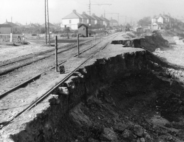 Sea damage at Penrhyn Bay, Caernarvonshire, Wales, along part of the tramway from Colwyn Bay and Llandudno. Date: October 1945