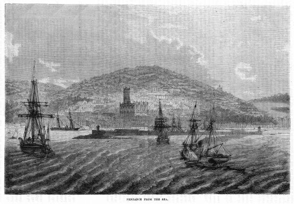 A steamer approaches the mouth of the harbour at Penzance, Cornwall, viewed from the sea