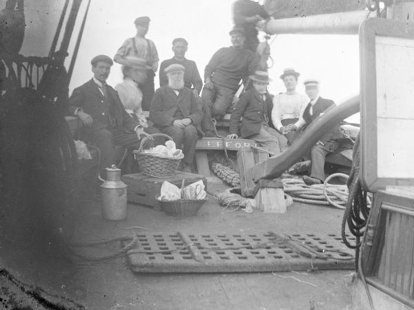 A group of people -- guests and crew -- on the deck of the good ship Effort, during a sea trip, probably off the coast of Pembrokeshire, Dyfed, South Wales