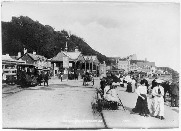 People on holiday enjoy a walk along the promenade in Douglas, Isle of Man