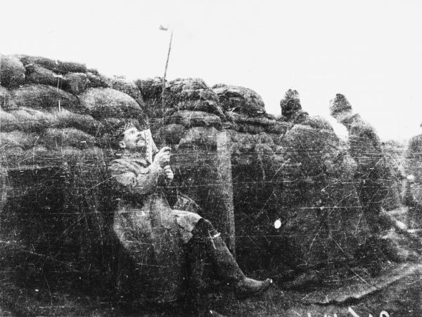 Lieutenant Kerr MC, who was later killed, using a periscope in a trench on Rue de Bois on the Western Front in France during World War I in February 1915