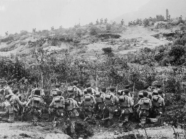 Columbian troops advancing across an arid terrain during the Peru-Columbia War, which was sparked off in 1932 after Peruvians seized the Amazon border town of Leticia. Date: May 1933