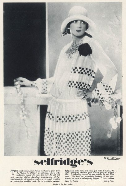 A petite woman in a summer dress from Selfridge's 'Salon for Petites' department. It is in ivory with navy blue spots, and is ideal for Ascot. The price is 18 guineas