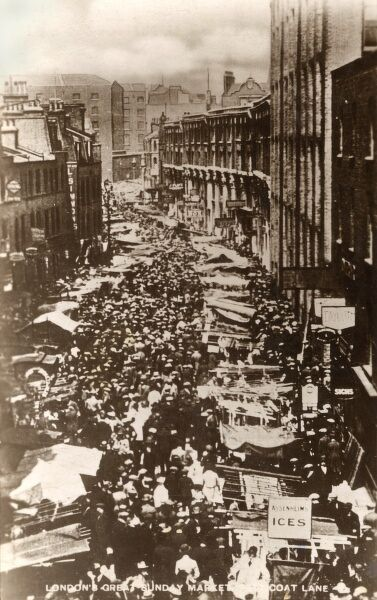 Petticoat Lane, London - a long shot. A street clothes market on Wentworth Street and Middlesex Street. Secondhand clothes and bric-a-brac had been sold in an area known as Peticote Lane since the early 17th century. An influx of immigrant Huguenots
