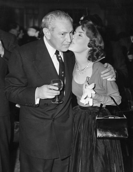 Petula Clark (b. 1932) English singer kissing Max Factor (1877-1938) Polish American businessman and cosmetician, at a party at the Dorchester that he gave to meet the stars
