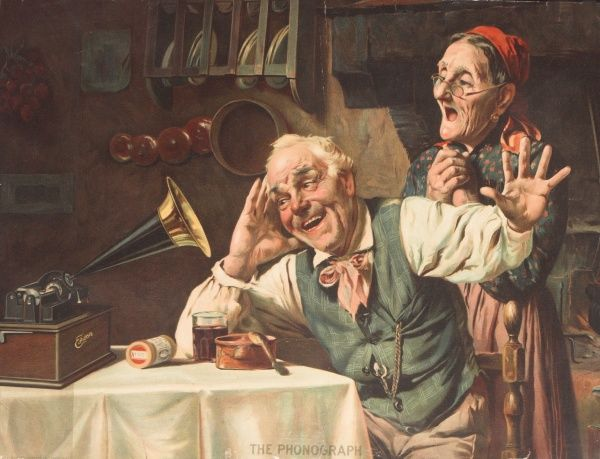 Illustration showing a jolly elderly couple enjoying the sounds of a brand new invention - the phonograph. The wax cylinders can be seen on the table by the machine