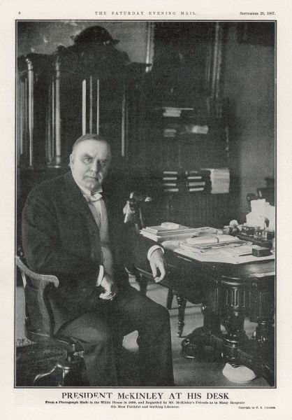 WILLIAM MCKINLEY President McKinley photographed at his desk in the White House in 1898