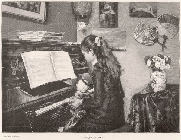 A young girl sits her doll on her lap and 'teaches' it to play the piano