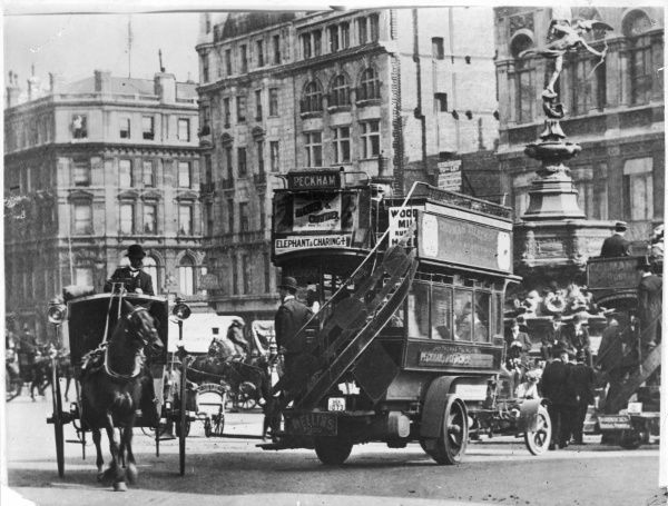 A horse bus and a motor bus in Piccadilly Circus