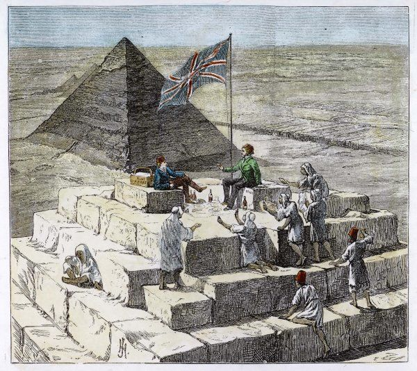 Tourists enjoy a picnic on the Great Pyramid