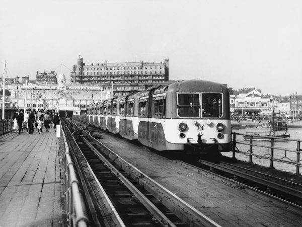 The electric train carries passengers to the end of the one and a half mile long pier, the longest in the world
