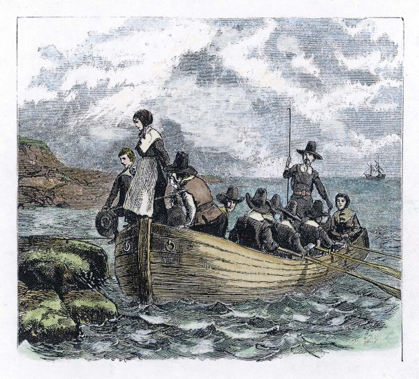 The first boat-load of 'Pilgrims' lands on the New England coast : John Alden and Mary Chilton are the first to set foot on American soil