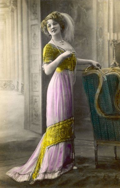 The Directoire / Empire silhouette: a high-waisted pink & gold gown with an ornately embroidered corsage & decorative panel on the narrow trained skirt