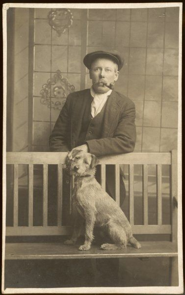 A pipe-smoker and his dog