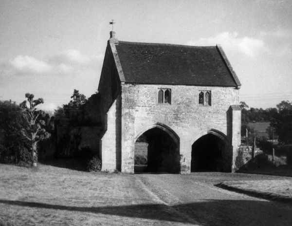 The massive gatehouse at Place Farm, Tisbury, Wiltshire. the entrance to a fine range of medieval domestic buildings. The lower part is 13th century, the upper is 15th. Date: 13th & 15th century