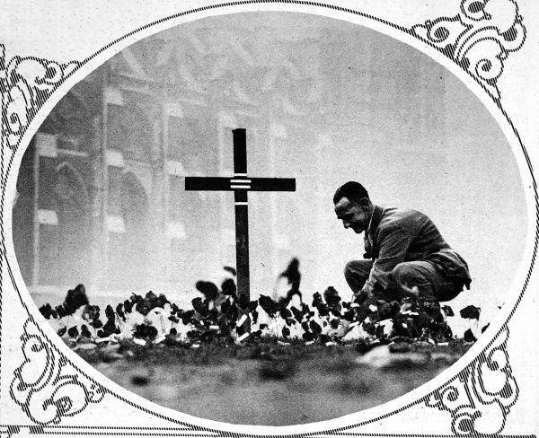 The tenth anniversary of the Armistice at Westminster Abbey. An ex-serviceman from the British Legion placing a poppy on the Garden of Remembrance