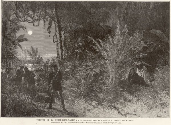 'The Crocodile', a play by Michel Sardou, is performed at the Theatre de la Porte-Saint-Martin in Paris. The scene shows the moment when Lieutenant Lotus discovers Richard Kolt and Miss De Witt hiding in the foliage