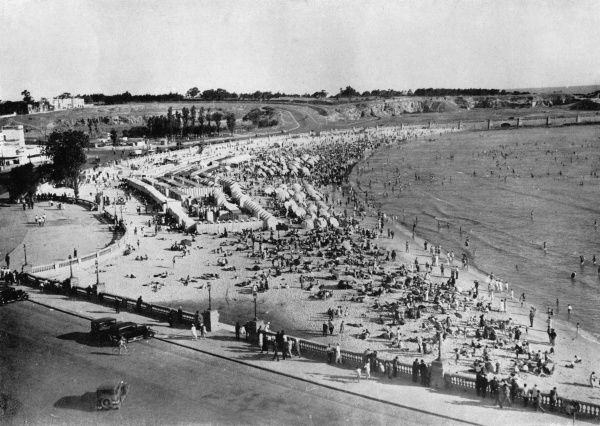Playa Ramirez, Montevideo, Uruguay during wartime, with rows of beach huts