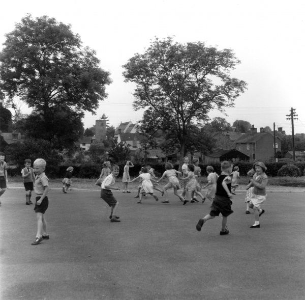 Children in the playground of Bramfield Primary School, Suffolk. Date: July 1957