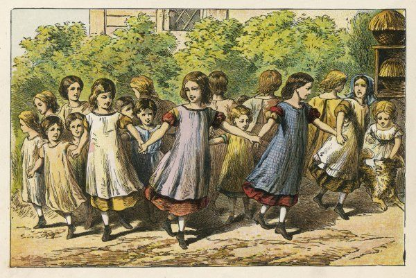 Little girls in petticoats and pinafores play 'Ring O' Roses' together in a school playground