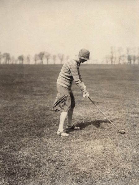 A lady playing golf at Falsterbo Colf Club, the only true links in Sweden. Date: 1920s
