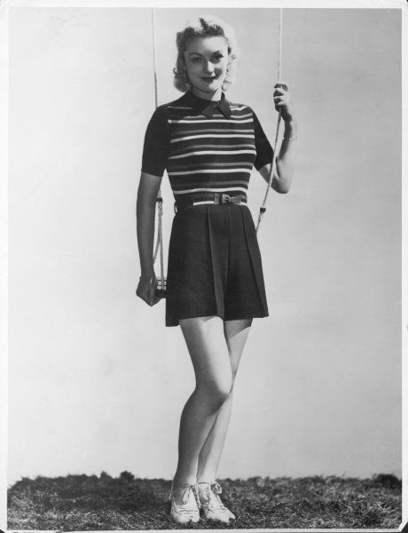 A playsuit by Hanro composed of navy shorts and a striped top with collar. Worn here with a pair of espedrilles