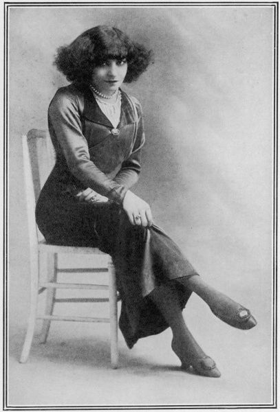 Emilie Polaire (1877 - 1939), French actress and music hall entertainer reputed to have the smallest waist in the world, wearing a pair of shoes which have a watch as an ornament