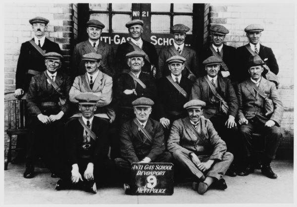 A group of police officers at an anti-gas training school in Devonport, Plymouth. Their gas mask bags are worn across one shoulder. 1/2 pictures. See 10193288 for 2/2