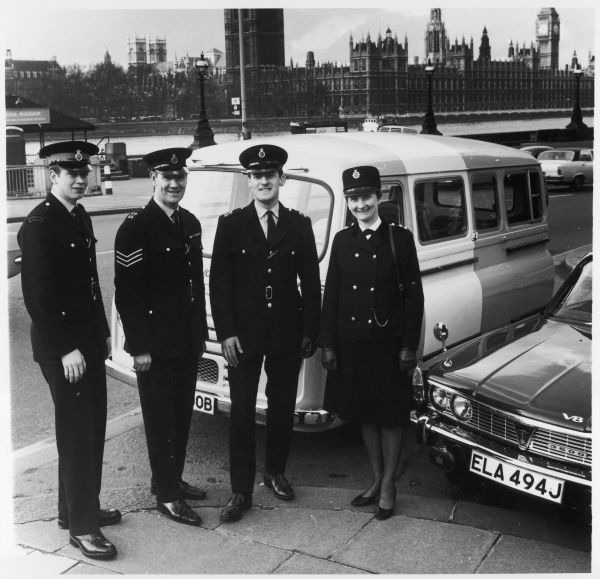 The Metropolitan Police Careers Team opposite the Houses on Parliament with their mobile office van preparing for their tour of N.E. Scotland