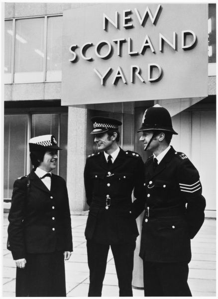 The Metropolitan Police Careers Team outside New Scotland Yard. WPC Patricia Allen, Inspector Ralph Wilkinson and Sergeant Tony Craighill