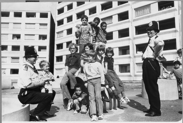 Metropolitan Police officers on Chalk Hill Estate, Wembley, talking to children and teenagers