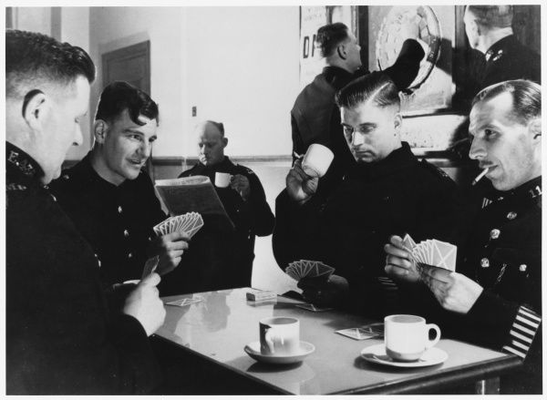 Group of Metropolitan Police officers on a coffee break, playing a game of cards