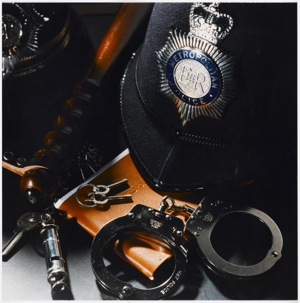 Metropolitan Police equipment including a helmet, handcuffs, whistle, keys and truncheon Date: circa 1991