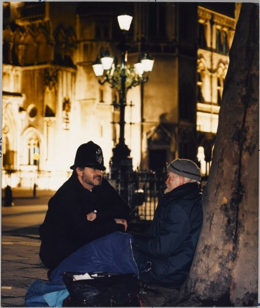 Police officer talking to a homeless man at night Metropolitan Police
