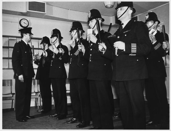 Police Officers line up for inspection with their truncheons and notebooks Metropolitan Police