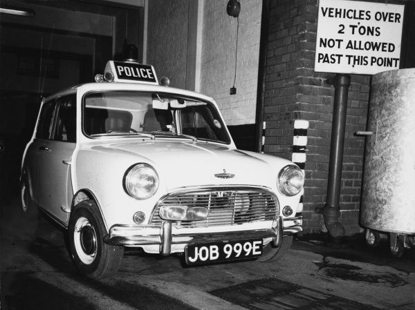 This mini, with a 1275 cc engine and the amusing number plate 'JOB 999E', was specially adapted for police duties, ideal for traffic control in congested areas. Date: 1960s