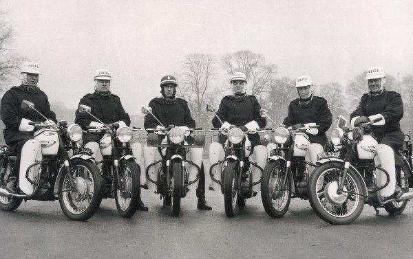 The Metropolitan Police Motorcycle Team at Crystal Palace Centre. Five of the riders are wearing white corker helmets and all are riding White Triumph motorcycles with white legshields and front numberplates, denoting this picture was taken pre-1975