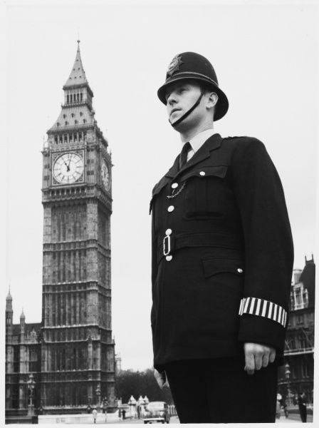 Police officer on duty outside Big Ben and the Houses of Parliament, London Metropolitan police