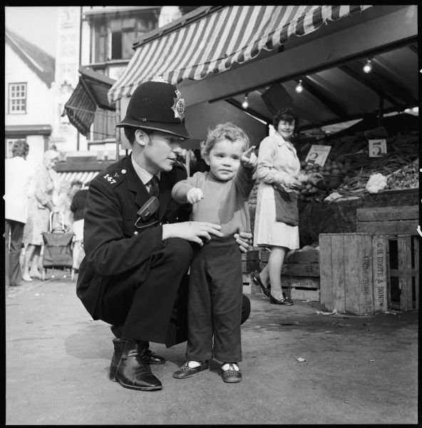 Police officer talking to a lost boy asking directions Metropolitan Police