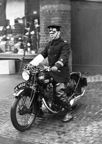 A Metropolitan Police officer riding a BSA motorcycle in London. The BSA could travel at up to 70 miles per hour