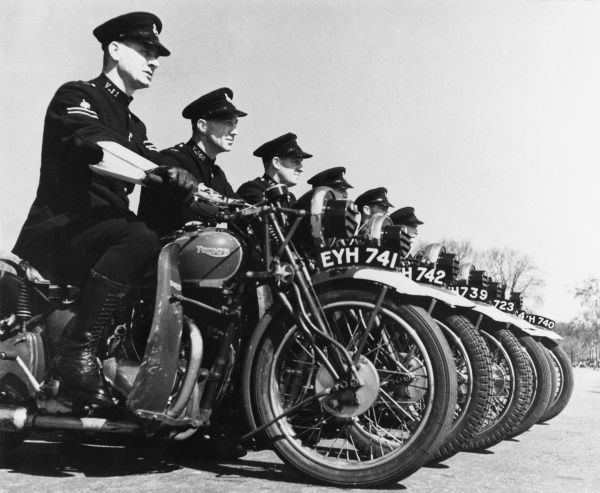 A long line of Metropolitan Police officers on their Triumph motor cycles