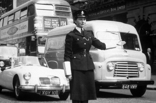 A policewoman on traffic duty on a busy day in London