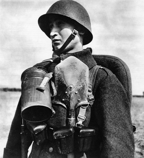A Polish infantryman in full war kit complete with shovel. The Illustrated London News calls him 'a type of soldier who can endure privation, make long marches without difficulty, and prefers hand to hand fighting.' Date: August 1939