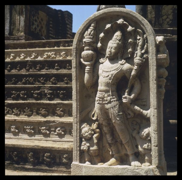 A guardian at the steps of the VATA DAGA in the quadrangle of Polonnaruwa, the ancient capital of Sri Lanka from the 11th to the 13th century