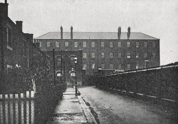 A side view of one of the blocks of the Poplar Union workhouse, located on Poplar High Street, East London