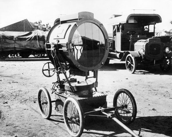 A large portable searchlight on a wheeled trolley used during the First World War. Date: 1914-1918