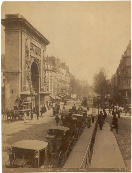 A street scene in front of the Porte Saint Denis - one of the original gates into the city