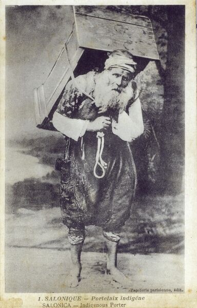 Indigenous barefooted elderly Turkish porter, carrying a small wooden cabinet - Thessalonika Date: circa 1910s