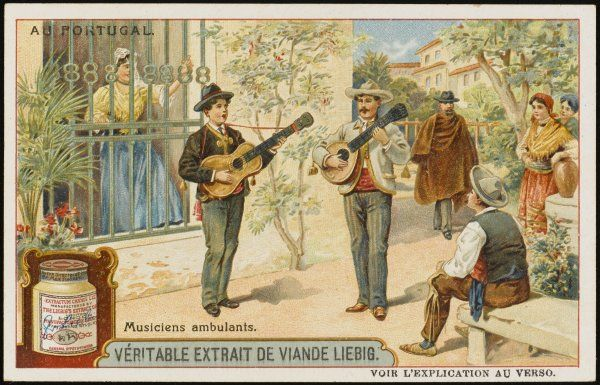 Two guitarists entertain residents and passers-by in the streets of a Portuguese town